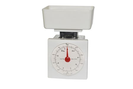 Plastic kitchen scale isolated over white. Weight measurement intrument photo