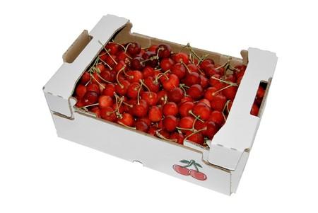 cherries isolated: A carton box plenty of cherries