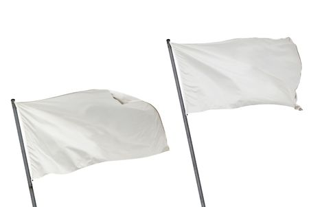 Two white flags waving on the wind. Isolated over white.