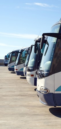 Some buses parked in the parking. Public transportation