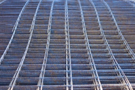 corroding: Metal mesh made with rusty iron rods.  Stock Photo