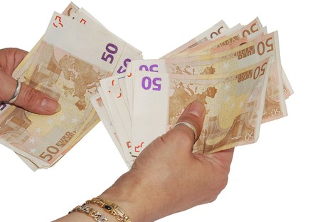 euro banknotes: Two woman hands are making a payment with some euro banknotes Stock Photo