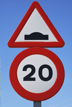 Two spanish traffic signs. Limit of velocity and speed bump Stock Photo - 7957614