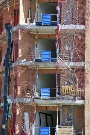 scaffolds: Building in construction with scaffolds and nets