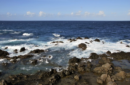 Volcanic rocks n the coast. Puerto de la cruz, Tenerife. Spain Stock Photo - 8424702