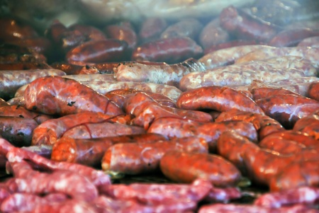 fatten: Barbecue made with sausages and spanish chorizo. Fat and cholesterol