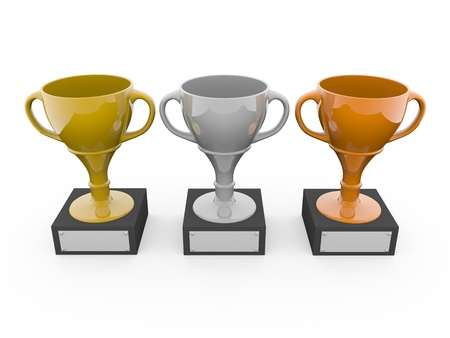 Three metal trophys. Gold, silver and bronze photo