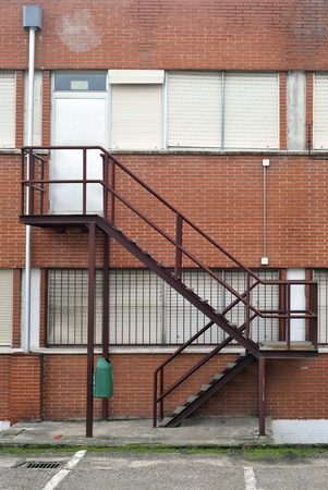 fire escape: Emergency metallic stairs in the facade of a building.  Editorial