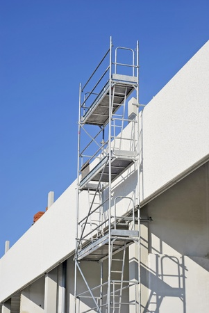 Metallic scaffold. Security stairs and platform for working Stock Photo - 11691915