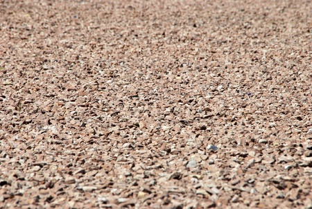 red soil: Red gravel background with depth of field