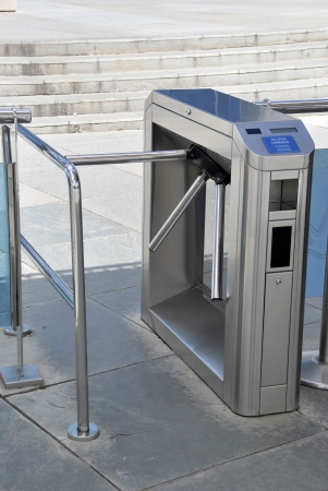 barrier: turnstile security access  Metal barrier for entry to events and places