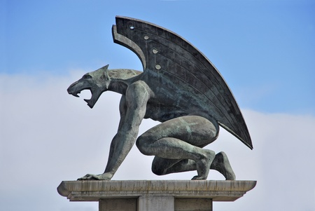 valencia: One of the four guardian gargoyles over Pont del Regne  bridge of the kingdom   Valencia Stock Photo