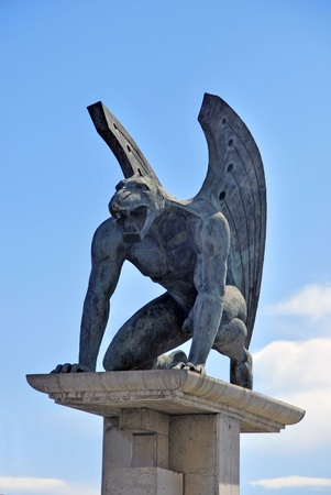 One of the four guardian gargoyles over Pont del Regne  bridge of the kingdom   Valencia photo