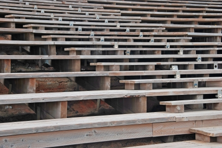 Rows of Wooden seats for an outdoors spectacle photo