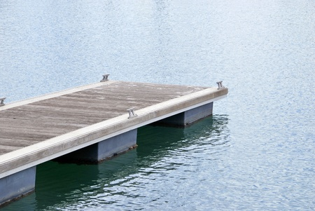 Modern pier on the harbor. Tranquil scene photo