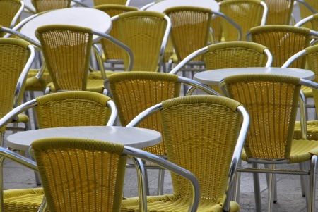 Empty chairs and tables in a bar terrace Stock Photo - 14589711