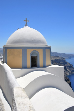 Christian church dome in Fira. Santorini, Greece photo