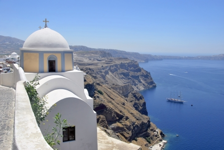 Panoramic view of the Caldera of Santorini Island seen near a church. Greece, Europe photo