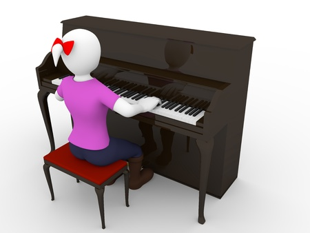 A woman is playing a brown piano photo