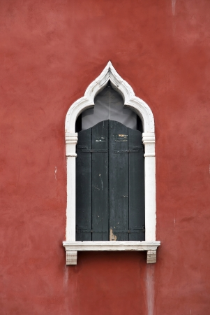 Detail of an old venetian style window. Venice. Italy photo