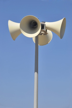 loud speaker: Street megaphones over the sky. Messages, warnings and communication system Stock Photo