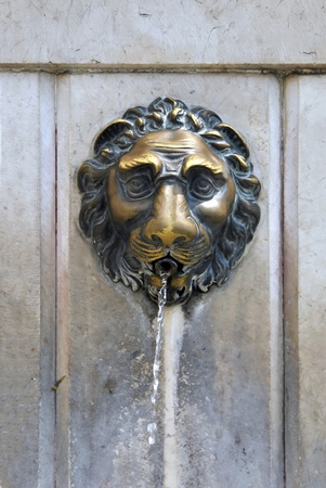 Street faucet with a lion head in Venice. Italy photo