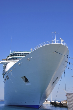 moored: Cruise ship moored in the harbor. Luxury travel and holidays Stock Photo