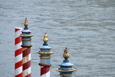 mooring: Typical striped poles for mooring boats in Venice. Italy