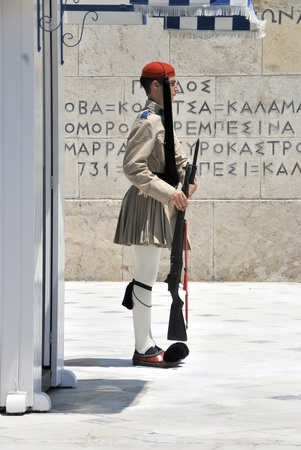 syntagma: Greek soldier standing in the Changing of the Guard Ceremony near Syntagma Square  Greek soldier wearing a traditional uniform Editorial
