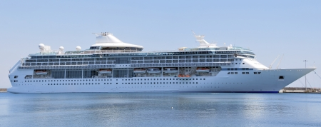 A big cruise ship moored in the harbor photo