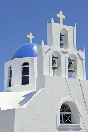 Typical church with a blue dome in Fira, Santorini island. Greece photo