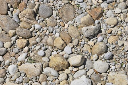 Rounded stones in a dry river. Construction material