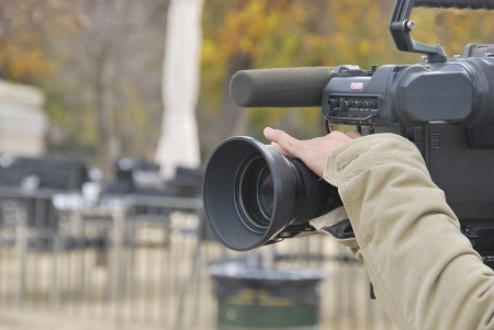 television production: A hand is operating a tv camera