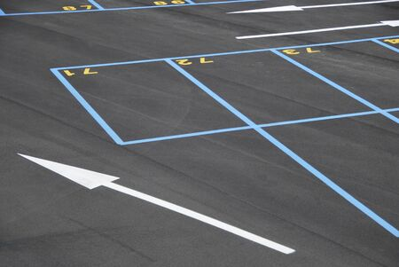Empty parking places. All of them are numbered and painted in blue photo