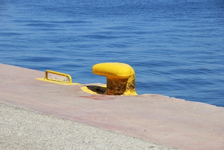 Iron pier painted in yellow in the harbor photo