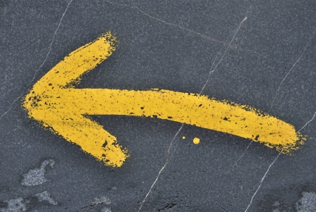 Yellow arrow painted in the ground. Sign of the Camino de Santiago. Way of saint James.  photo