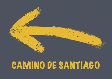 Gele pijl geel geschilderd. Teken van de Camino de Santiago. Pelgrimstocht naar Santiago.