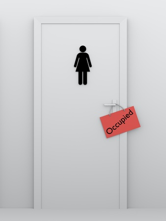 Womens bathroom door with a occupied sign in the door handle photo