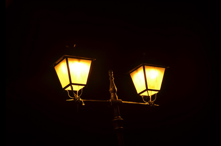 Street lamp iluminated in yellow  Urban illumination for night photo