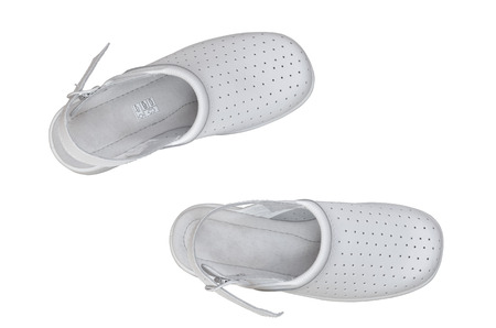 A pair of white professional comfortable shoes isolated over white