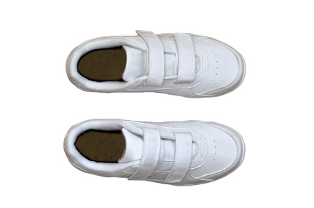 the sole of the shoe: Top view of a pair of white sneakers isolated over white