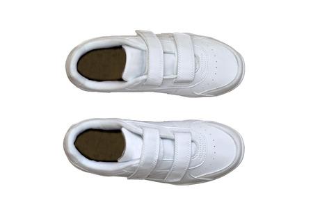 escarpines: Vista superior de un par de zapatillas blancas aisladas sobre blanco