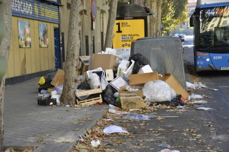 evident: MADRID, SPAIN - NOVEMBER 14: Garbage accumulation in the streets of Madrid due to strike on November 14, 2012 in Madrid Spain. dirt accumulation is evident an can cause sanitary problems
