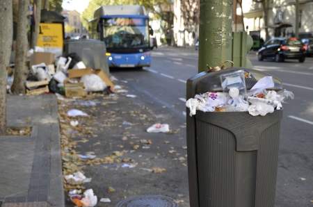 MADRID, SPAIN - NOVEMBER 14: Detail of a full paper bin in Madrid due to strike of garbage collection on November 14, 2012 in Madrid Spain.