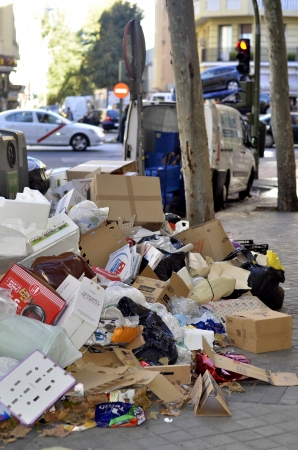 MADRID, SPAIN - NOVEMBER 14: Piles of garbage in the center of Madrid due to strike on November 14, 2012 in Madrid Spain. Source of infection for citizens