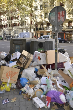 MADRID, SPAIN - NOVEMBER 14: Garbage accumulation in the streets of Madrid due to strike on November 14, 2012 in Madrid Spain. Garbage can produce sanitary problems