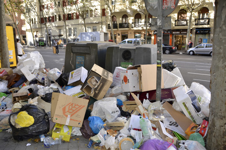 MADRID, SPAIN - NOVEMBER 14: Garbage accumulation in the streets of Madrid due to strike on November 14, 2012 in Madrid Spain.  Редакционное