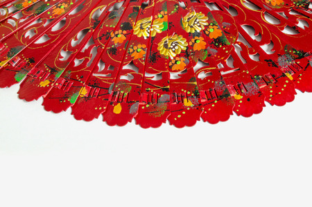 souvenir traditional: Typical spanish red fan over a white. Detail of the decoration based in flowers Stock Photo