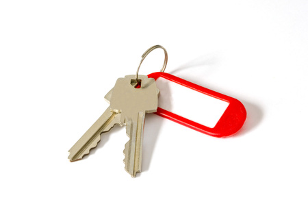 Two keys with a plastic tag label holder in red photo