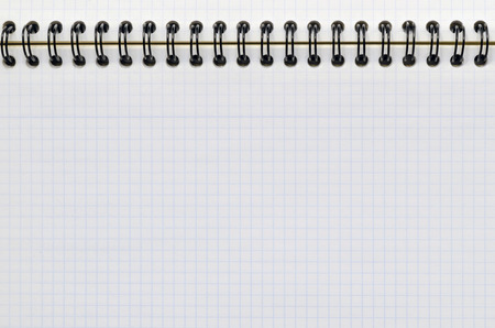 Detail of a sheet of graph paper in a notebook. Study and education concept photo